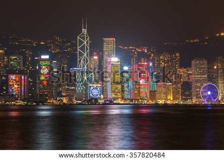 Hong kong - December 14, 2015 : View city skyline at night new year festival at victoria harbor with and urban skyscrapers in hong kong.