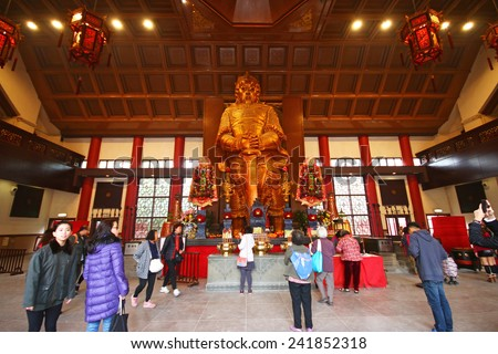 HONG KONG - DECTEMBER 27, 2014 : Pilgrims in the Che Kung taoist temple in Sha Tin, Hongkong. Taoism is a special way of belief practised mainly in Chinese-speaking  - stock photo