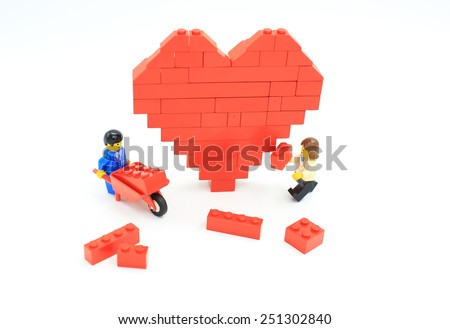 HONG KONG, FEB 14:  lego mini characters and bricks from different genration which are isolated on white in hong kong on 14 february 2014. Lego minifigure are the successful line in Lego products - stock photo