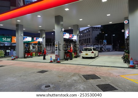 HONG KONG - FEBRUARY 04, 2015: Caltex fuel station at evening. Caltex is a petroleum brand name of Chevron Corporation used in more than 60 countries - stock photo