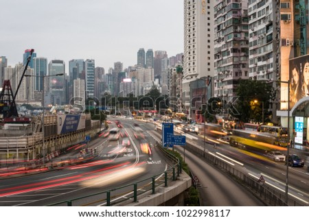 Hong Kong - February 2 2018: Cars and buses rush along the road between Causeway Bay and North Point by the waterfront in Hong Kong island in the evening