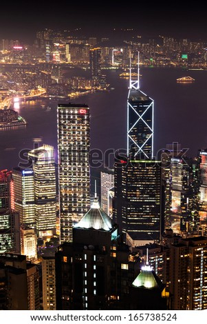 HONG KONG - FEBRUARY 22: Cityscape of Hong Kong island from Victoria peak on February, 22, 2013. The Victoria Harbour is world-famous for its stunning panoramic night view and skyline. - stock photo