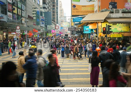 Hong Kong - FEBRUARY 18: People crossing the street at Mong Kok district, Kowloon, Hong Kong on February 18, 2014.