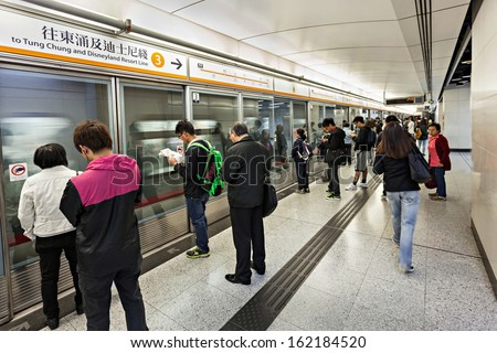 HONG KONG - FEBRUARY 23: Subway station interior on February 23, 2013 in Hong Kong. Over 90% daily travelers use public transport. Its the highest rank in the world. - stock photo