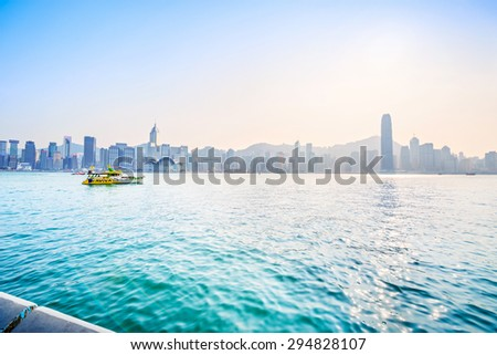 Hong Kong - February 8, 2015: Victoria Harbour of Hong Kong. In the distance is Hong Kong Central. Taken from Avenue of Stars. Located in Hong Kong.