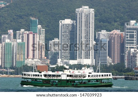 Hong Kong ferry in front of residential area
