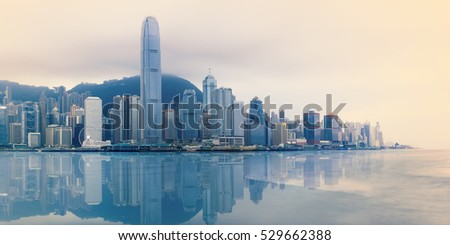 Hong Kong foggy evening on Victoria's harbour from Tsim Sha Tsui waterfront