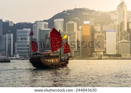 Hong Kong harbor with tourist junk - stock photo