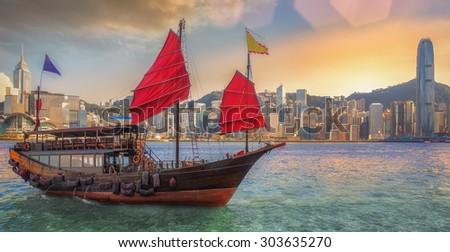 Hong kong harbor with vintage wood boat for transport between Hong kong island and Kowloon - stock photo