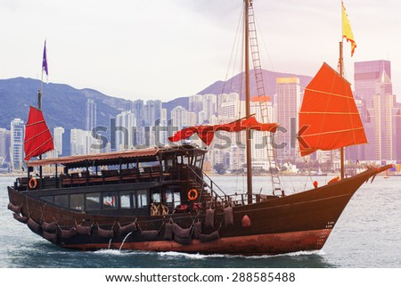 Hong Kong harbour with tourist ship - stock photo