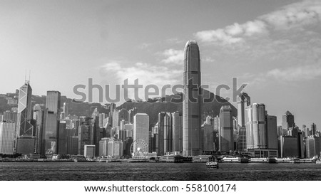 HONG KONG, HONG KONG - DECEMBER 10: Black and white sea front view with luxurious buildings in Hong Kong on  December 10, 2016