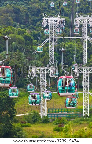 HONG KONG, HONG KONG - OCTOBER 01: cable cars over tropical trees in Hong Kong on October 01, 2012