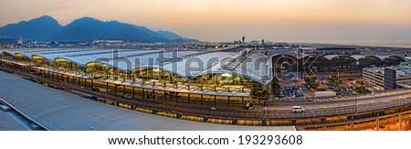 hong kong international airport wide angle at sunset - stock photo