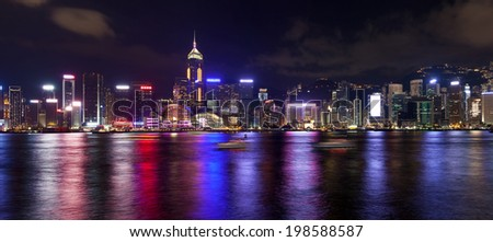 Hong Kong Island Central City Skyline Along Victoria Harbor at Night with Colorful Reflection Panorama