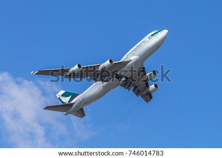 HONG KONG - JAN 23, 2017: Cathay Pacific airplane departing from the Hong Kong International Airport. About 90 airlines operate flights from HKIA to over 150 cities across the globe.