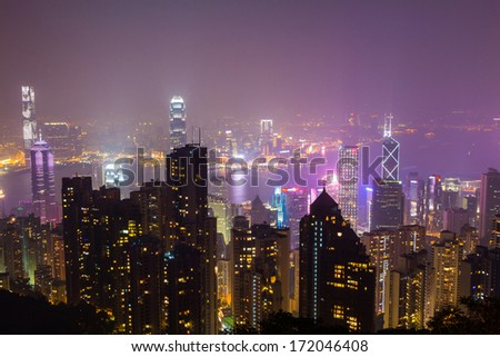 HONG KONG - JAN 12, 2014: Hong Kong skyline view from Victoria Peak to the bay and the illuminated skyscraper by night.