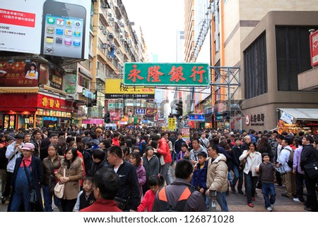 HONG KONG -JAN29: Shoppers and visitors crowd a street on Jan 29, 2011 in Hong Kong, China. Guangdong residents who will visit Hong Kong for shopping next Spring Festival will grow about 30% this year