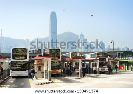 HONG KONG - JANUARY 14: Bus station on January 14, 2013 in  Hong Kong. With a land mass of 1,104 km and a population of 7 million people, Hong Kong is one of the most populated areas in the world - stock photo