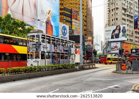 HONG KONG - JANUARY 28, 2015: Decker buses and trams on the central streets. Hong Kong is a leading financial centre of the world.