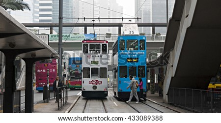 HONG KONG - JANUARY 16, 2016: In the Streets of Hong Kong, double-decker trams. Trams also a major tourist attraction and one of the most environmentally friendly ways of travelling in Hong Kong