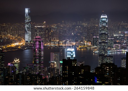 HONG KONG - January 23 : Scene of the Victoria Harbour from Victoria peak on January 23, 2015 in Hong Kong. Victoria Harbour is the famous attraction place for tourist to visit. - stock photo
