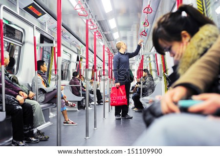 HONG KONG - JANUARY 21: Unidentified people inside a subway train on January 21, 2013 in Hong Kong. MTR had 46.4% of the public transport market, making it the most popular transport in Hong Kong  - stock photo