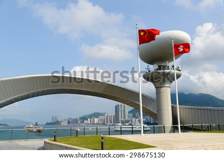 HONG KONG - JUL 8, 2015: Kai Tak Cruise Terminal is opened at the site of the former Kai Tak Airport. It can accommodate two mega cruise ships with a gross tonnage of up to 220,000 tons. - stock photo