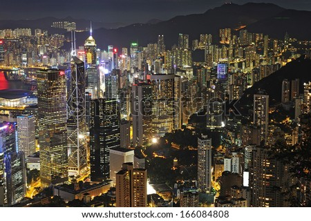 HONG KONG - JULY 03: Cityscape of Hong Kong island from Victoria peak on July, 07, 2012. The Victoria Harbour is world-famous for its stunning panoramic night view and skyline.  - stock photo