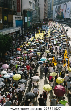 HONG KONG - JULY 1: Hong Kong people show their dissatisfaction to the Hong Kong government by march on July 1, 2015 in Hong Kong. Organizers of protest claimed a turnout of 48,000 people.
