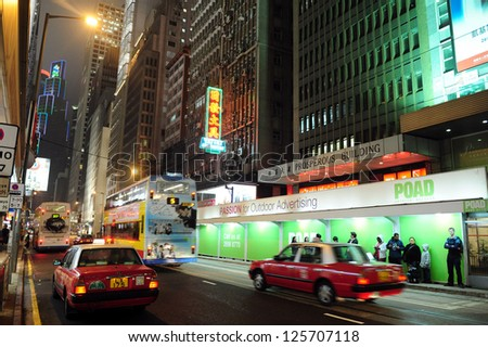 HONG KONG - JULY 07 2008:Hong Kong Taxi Cabs seek for a new passengers in Hong Kong at night. Taxicabs in Hong Kong serve every day over 1 million people