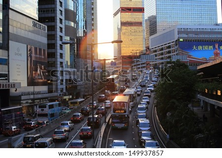 HONG KONG, JULY 10: the cars is in queue in the traffic jam in Central on 10 july 2013.  6 p.m. is the peak of rushing hour in central because all people come off work