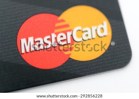 HONG KONG - JUN 15, 2015: Mastercard Credit Card Sign Close Up. Throughout the world, its principal business is to process payments between the banks of merchants and the card issuing banks. - stock photo