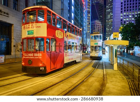 HONG KONG - JUNE 03, 2015: double-decker tram on street of HK. Hong Kong Tramways is a tram system in Hong Kong, being one of the earliest forms of public transport in the metropolis - stock photo