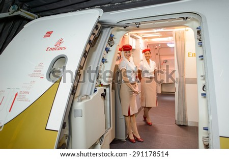 HONG KONG- JUNE 18, 2015: Emirates crew meet passengers on second floor of A380. Emirates is one of two flag carriers of the United Arab Emirates along with Etihad Airways and is based in Dubai - stock photo
