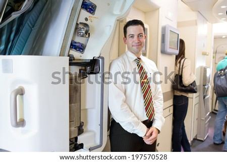 HONG KONG -JUNE 04: Emirates crew member meet passengers in Airbus A380 on June 04, 2014 in Hong Kong, China. Emirates handles major part of passenger traffic and aircraft movements at the airport. - stock photo