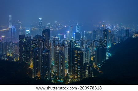 HONG KONG - June 15: Hong Kong city skyline at night over Victoria Paek June 15 2014. Victoria peak is a mountain in the western half of Hong Kong Island. It is also known as Mount Austin