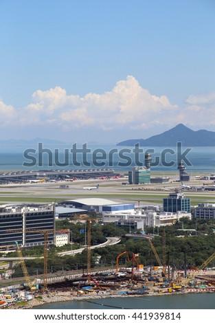 HONG KONG - JUNE 19, 2016: Hong Kong International Airport on June 19, 2016 in Hong Kong, China . The airport bay is undergoing land reclamation to build the Zhuhai-Macau-Hong Kong bridge. - stock photo