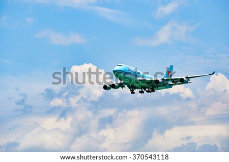 HONG KONG - JUNE 04, 2015: Korean Air aircraft landing at Hong Kong airport. Korean Air is the largest airline in South Korea based on fleet size, international destinations and international flights. - stock photo