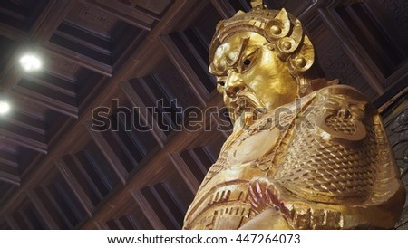 HONG KONG - 19 JUNE 2016; the large golden statue of CHE KUNG at Sha Tin temple in HONG KONG that can be attractive tourist places.