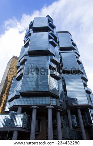 HONG KONG - JUNE 30 :The Lippo Centre in Hong Kong on June 30,2014. The Lippo Centre is a twin office towers in Hong Kong designed by American architect Paul Rudolph. - stock photo