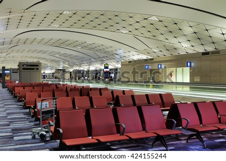HONG KONG - JUNE 17,2016: The red seats and modern interiors building in departure zone at Hong Kong International Airport.
