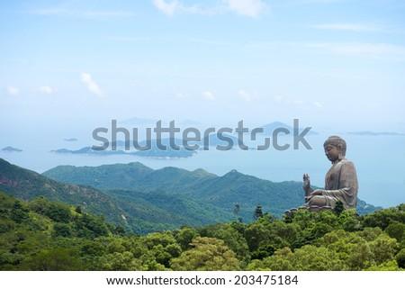 Hong Kong, Lantau Island Giant Buddha of Po Lin Monastery with blue sky - stock photo