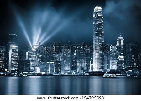 Hong Kong lit up at night - stock photo