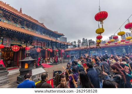 HONG KONG - MAR 10, 2014: Crowded day at Sik Sik Yuen Wong Tai Sin Temple in Hong Kong. It is one of the largest and commemorates the famous monk of yore, Wong Tai Sin also known as Huang Chu-ping. - stock photo