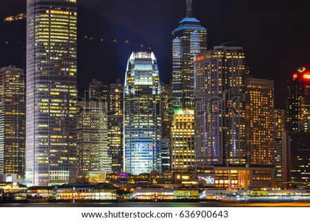 Hong Kong - Mar 31, 2017. Finance district at night in Hong Kong. Hong Kong has a free market economy, highly dependent on international trade and finance.
