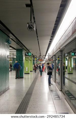 HONG KONG - MAR 29 : Tourists and locals walking access to the subway on March 29,2015 at MTR hong kong - stock photo
