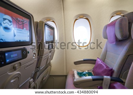 HONG KONG - MARCH 08, 2016: inside of Emirates Airbus A380. The Airbus A380 is a double-deck, wide-body, four-engine jet airliner manufactured by Airbus. It is the world's largest passenger airliner. - stock photo
