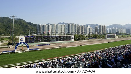 HONG KONG - MARCH 18: Mercedes-Benz Hong Kong Derby 2012 is held in Shatin racecourse on March 18, 2012, Hong Kong, China. It is one of the most prestigious races on the domestic racing calendar. - stock photo