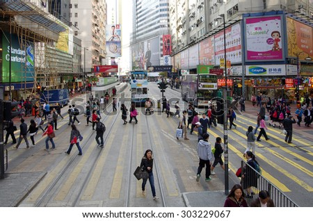HONG KONG - MARCH 05: Shoppers and visitors crowd on March 05, 2013 in Hong Kong. Shoppers and visitors crowd at one of the shopping street at Hong Kong