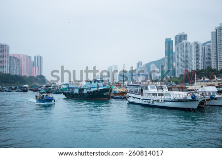 HONG KONG-MARCH 12:Traditional fishing trawler in the Aberdeen Bay. Famous floating village in Aberdeen is an area and town on the south shore of HongKong Island in partly cloudy day on march 12 ,2015